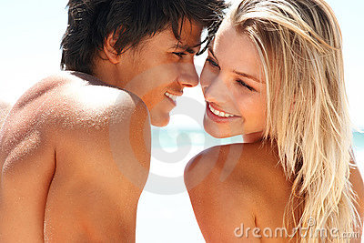 Happy romantic couple together at the beach