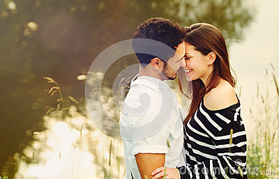 Happy romantic sensual couple in love together on summer vacatio Stock Photo