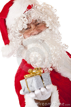 Happy Santa Claus holding Christmas gift in hand