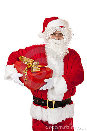 Happy Santa Claus holding Christmas gift in hands