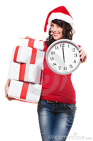 Happy santa girl holding gifts and clock