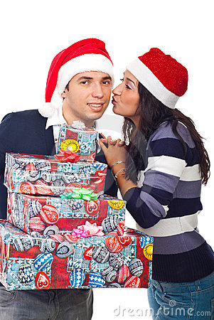 Happy Santa man being kissed by woman