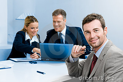 Happy satisfied businessman with colleagues
