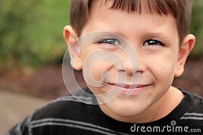 Happy school child joyful face