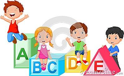 Happy school children playing with alphabet blocks Stock Photo