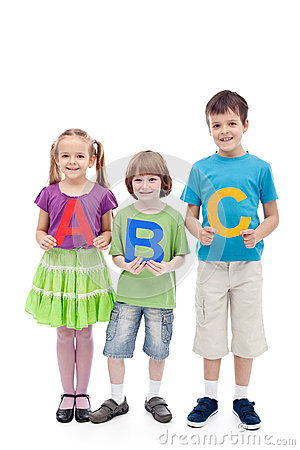 Happy school kids holding large abc letters