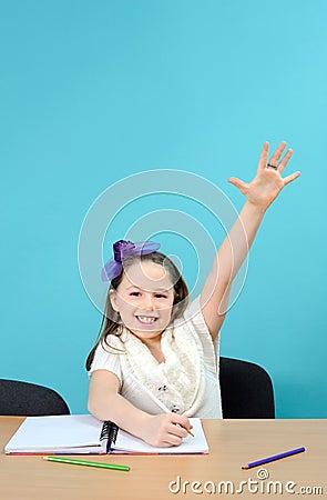 Happy schoolgirl doing her school work