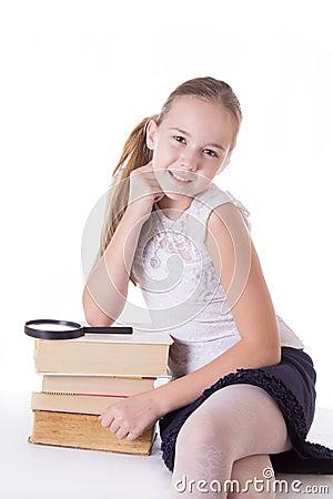 Happy schoolgirl with pile of books Stock Photo