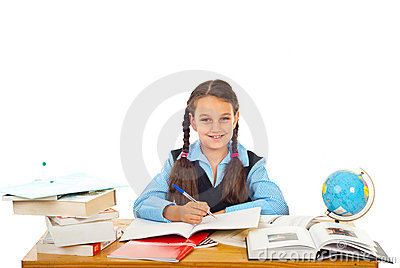 Happy schoolgirl writing at pupil