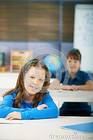 Happy schoolgirls in classroom