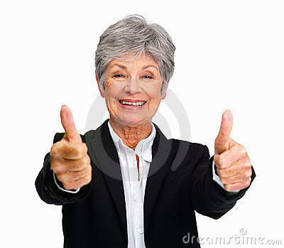 Happy senior business woman showing thumbs up sign