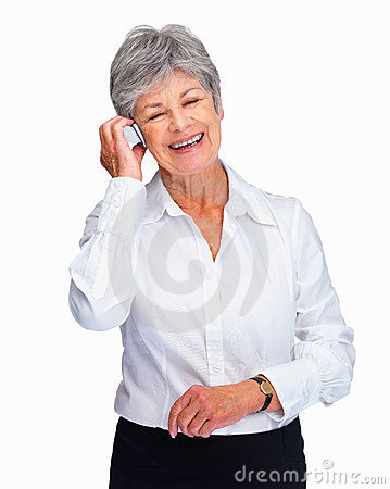 A happy senior business woman using cellphone