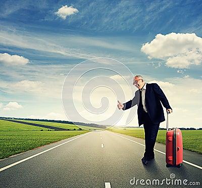 Free Happy Senior Businessman Hitch Hiking Royalty Free Stock Photography - 34571407