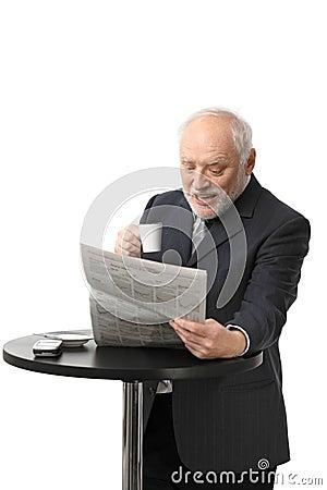 Free Happy Senior Businessman Reading Newspaper Royalty Free Stock Photography - 23095617