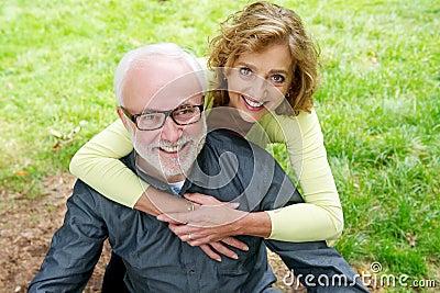 Happy senior caucasian couple smiling outdoors