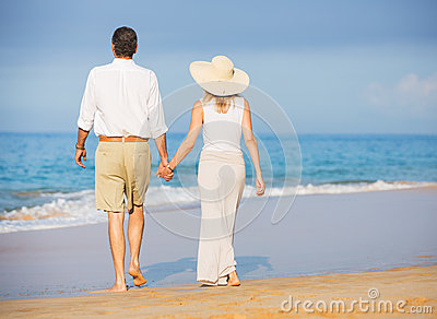 Happy senior couple on the beach. Retirement Luxury Tropical Res