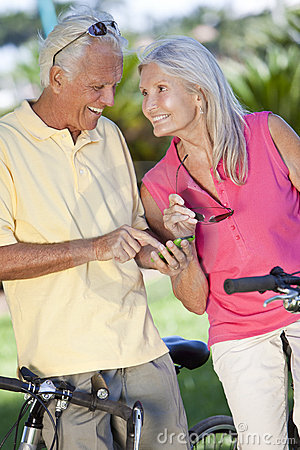 Free Happy Senior Couple Cycling Using Smart Phone GPS Stock Image - 19299611
