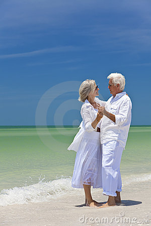 Free Happy Senior Couple Dancing On A Tropical Beach Royalty Free Stock Photos - 14437008