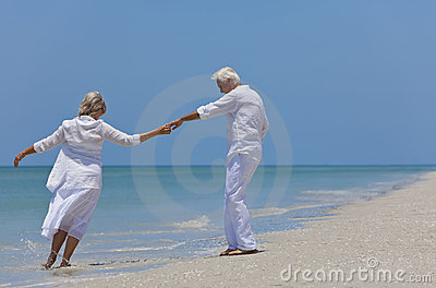 Happy Senior Couple Dancing on A Tropical Beach