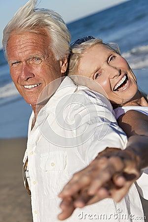 Happy Senior Couple Dancing on A Tropical Beach