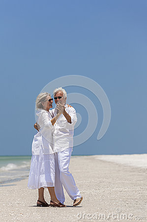 Happy Senior Couple Dancing on Tropical Beach