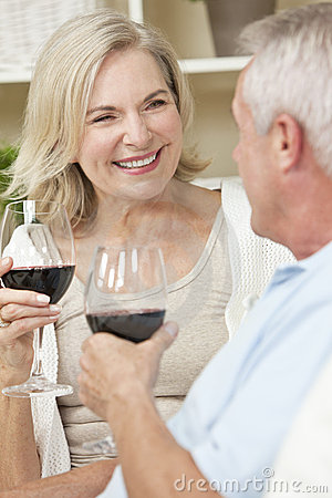 Happy Senior Couple Drinking Wine at Home