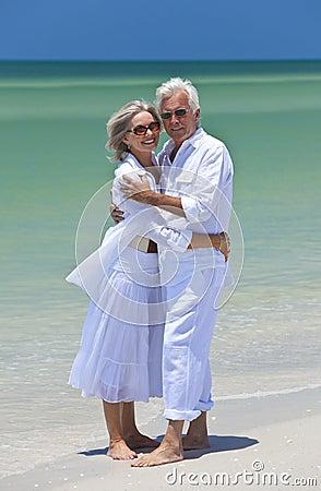 Happy Senior Couple Embracing on A Tropical Beach