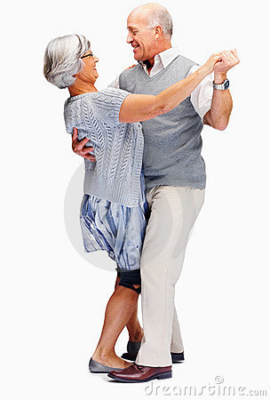 Happy senior couple enjoying a dance over white