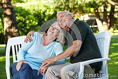 Happy senior couple in a garden