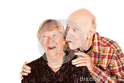 Happy senior couple looking left