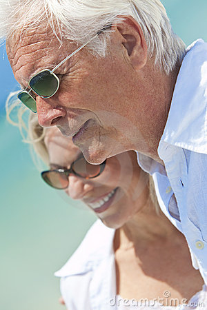 Happy Senior Couple Looking To Sea on a Beach