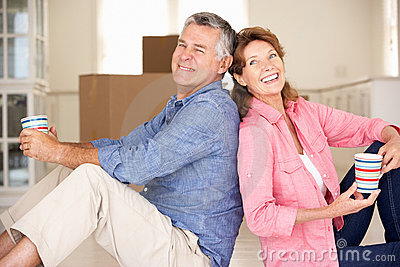 Happy senior couple in new home