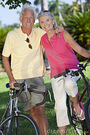 Free Happy Senior Couple On Bicycles In Green Park Royalty Free Stock Image - 19465966
