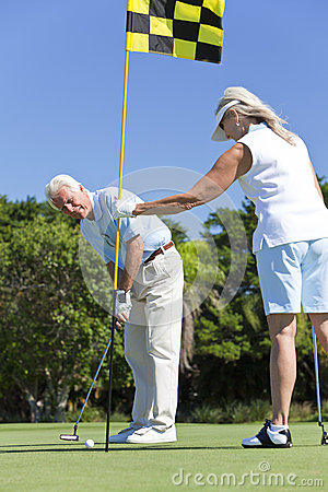 Happy Senior Couple Playing Golf Together