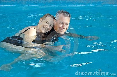 Happy senior couple in pool