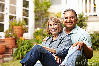 Happy senior couple relaxing in garden