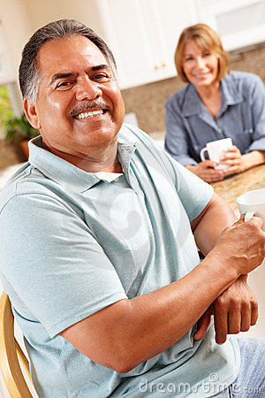 Happy senior couple relaxing in kitchen