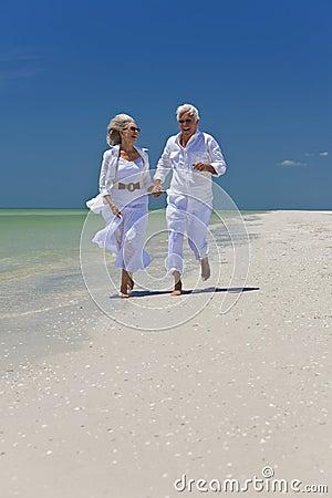 Happy Senior Couple Running on A Tropical Beach