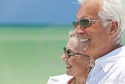 Happy Senior Couple By the Sea on A Tropical Beach