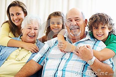 Happy senior couple with their grand children