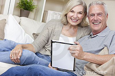Happy Senior Couple Using Tablet Computer
