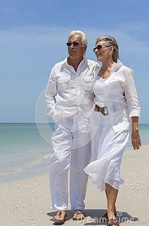 Free Happy Senior Couple Walking By Sea On Tropical Beach Royalty Free Stock Photography - 29202437