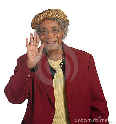 Happy senior lady waving