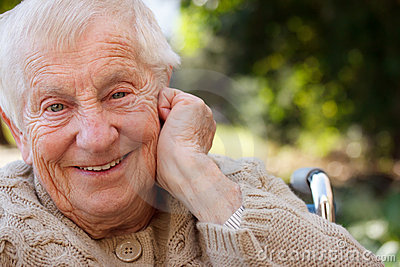 Happy senior lady in wheelchair