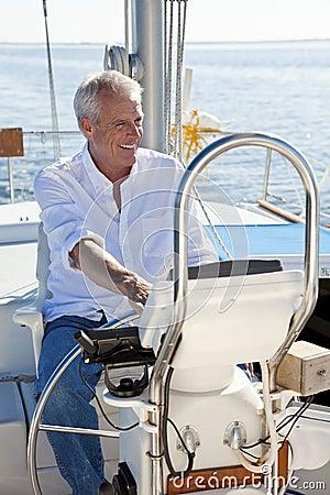 Free Happy Senior Man At The Wheel Of A Sail Boat Royalty Free Stock Photos - 20954988