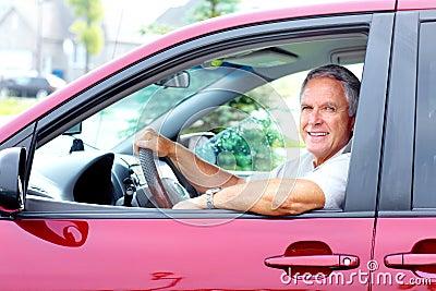 Happy senior man in the car.