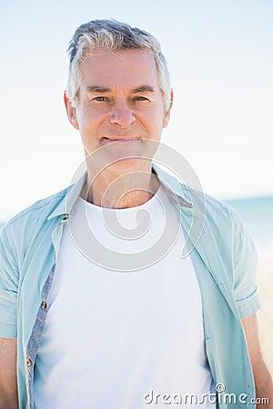 Happy senior man looking at camera