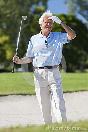 Free Happy Senior Man Playing Golf In Bunker Royalty Free Stock Photo - 29094135