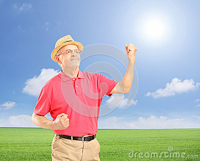 Happy senior man with raised hands gesturing happiness