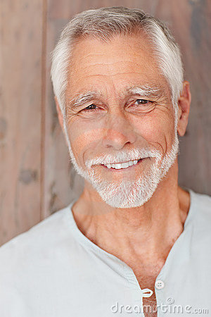 Happy senior man, smiling over a wooden background